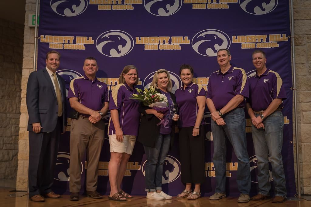 (Photo from left to right: Superintendent Steve Snell, board members Anthony Buck and Kathy Major, Stephanie Blay (holding flowers), board members Megan Parsons, David Nix, and Clay Cole).