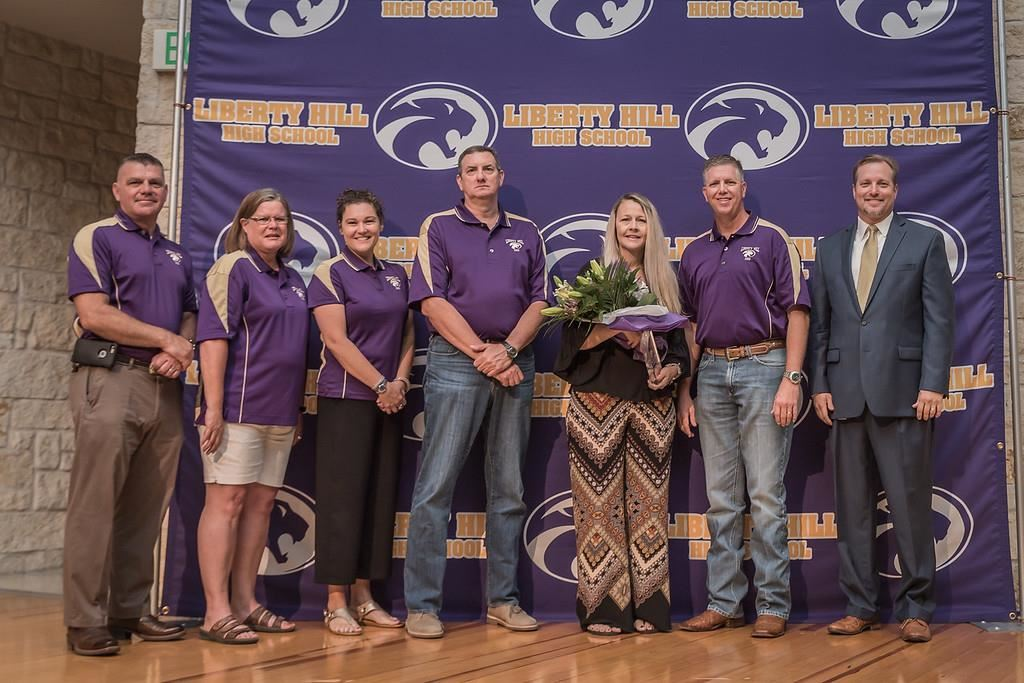 (Photo from left to right: board members Anthony Buck, Kathy Major, Megan Parsons, and David Nix, Stephanie Watson (holding flowers), board member Clay Cole, and Superintendent Steve Snell).
